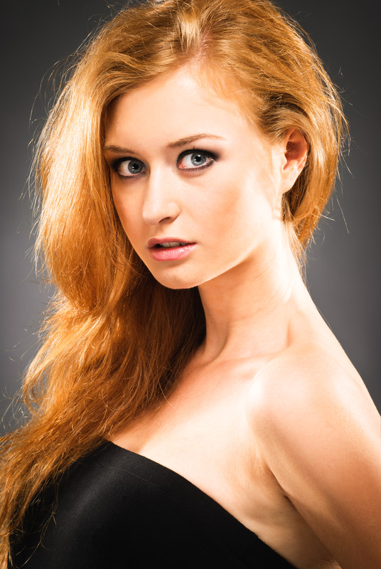 A young woman with long, red hair.