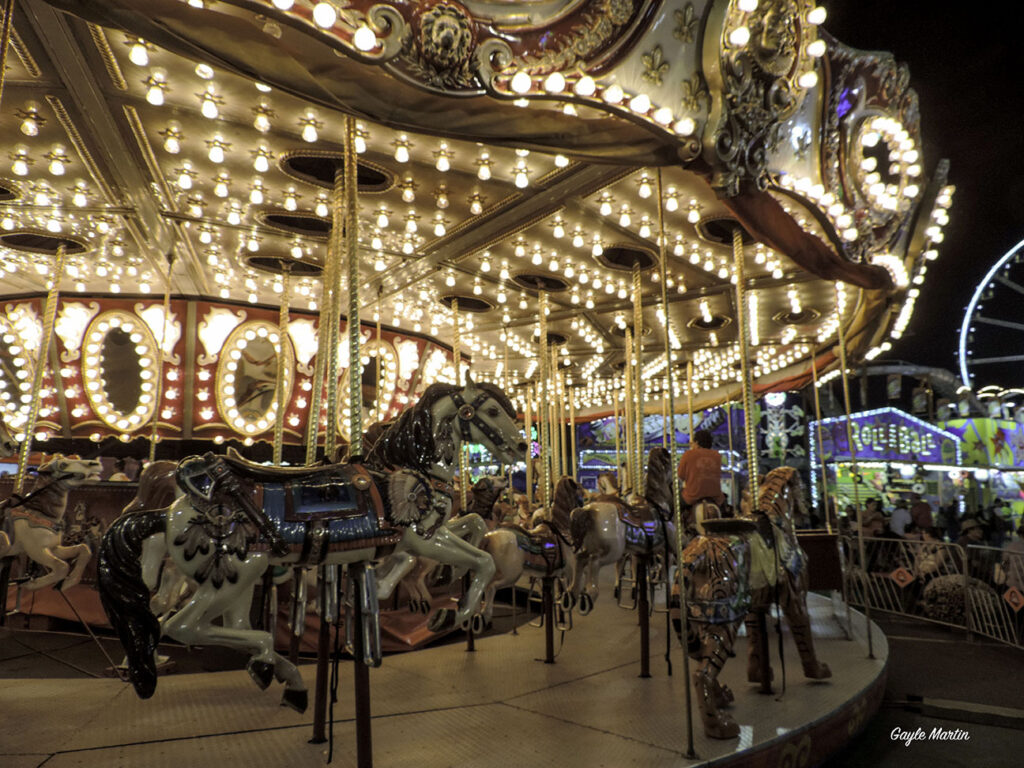 A photo of a merry-go-round at the fair.