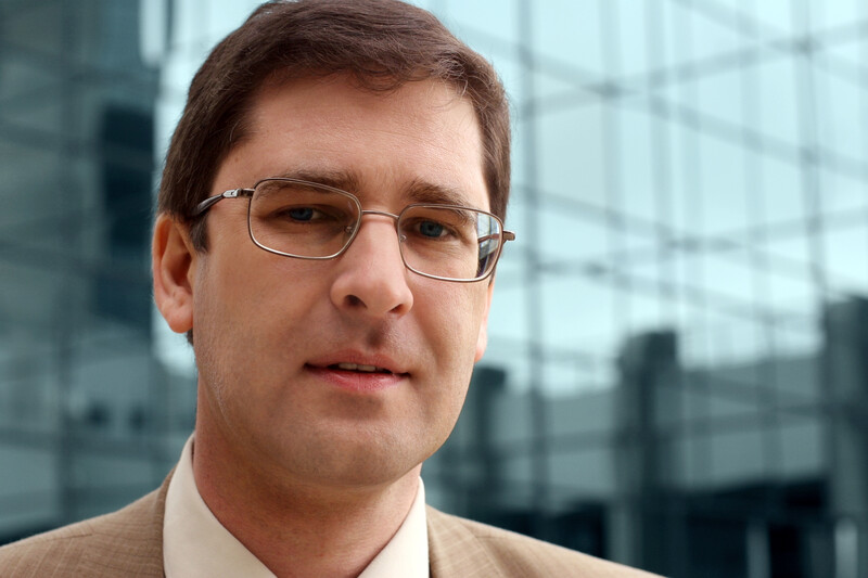 Photo of a businessman wearing glasses.