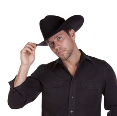 A man in his black cowboy hat tips it with his fingers to say hello.