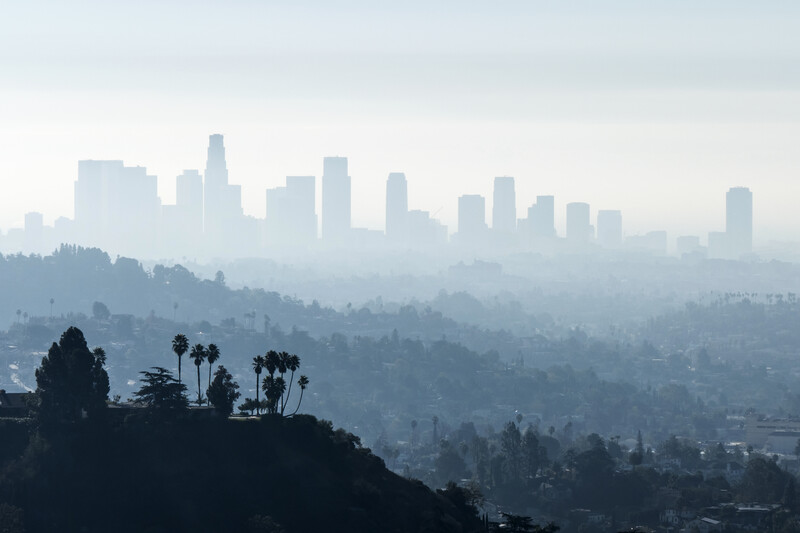 A photo of the Los Angeles skyline seen through mist.