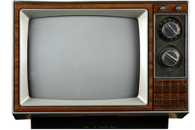 A old television set with a blank screen.