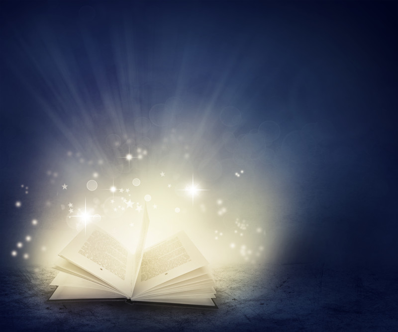 An open book with magical stars coming out of it.